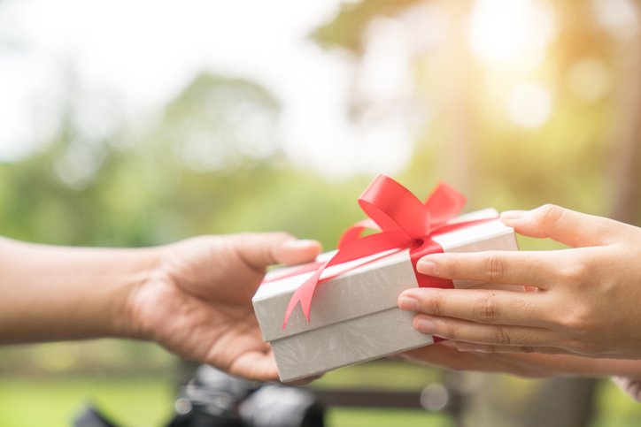 Person handing present to someone else