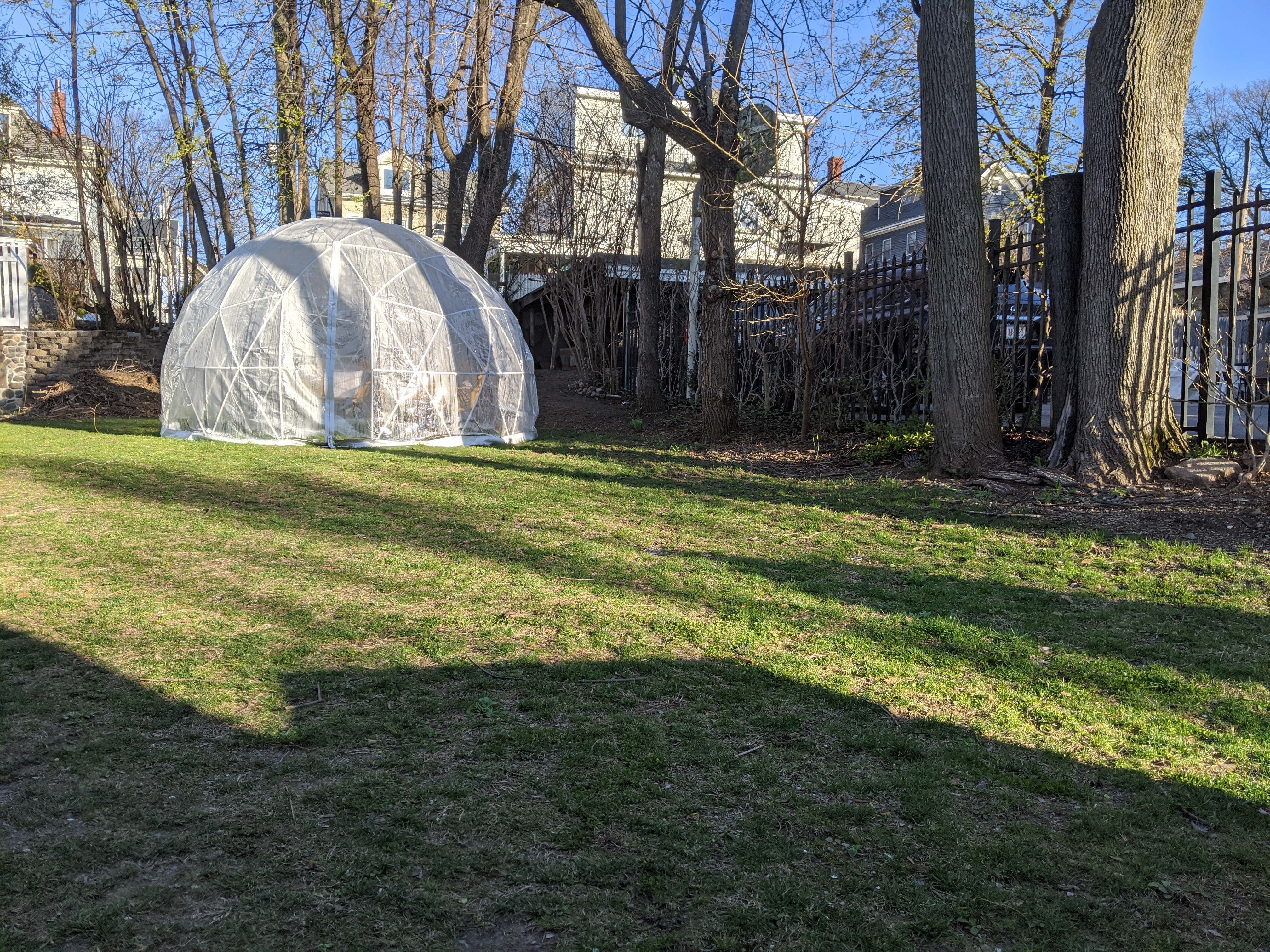 A backyard with an igloo tent