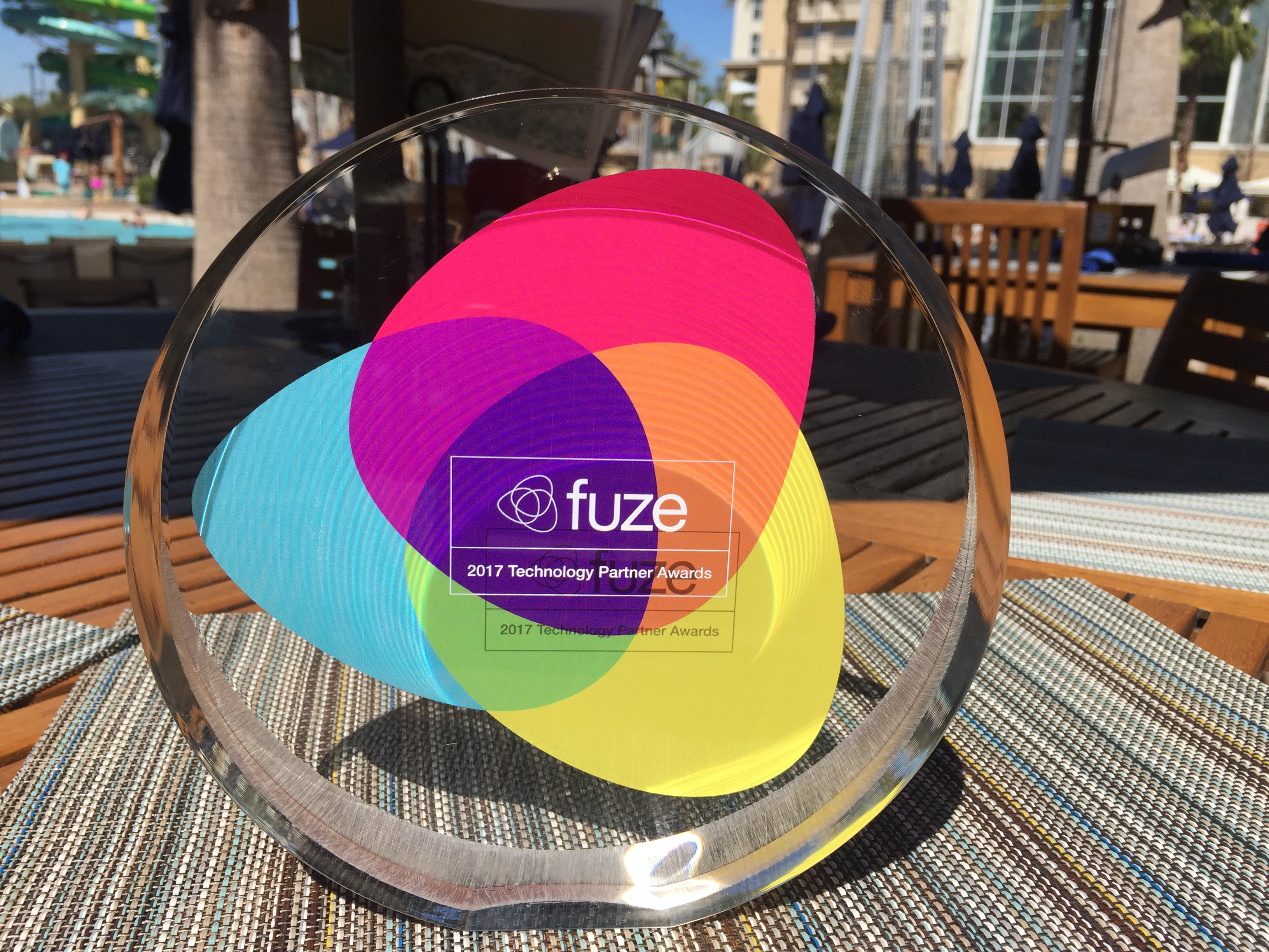 Multicolor glass Fuze Partner award sitting on a table outside