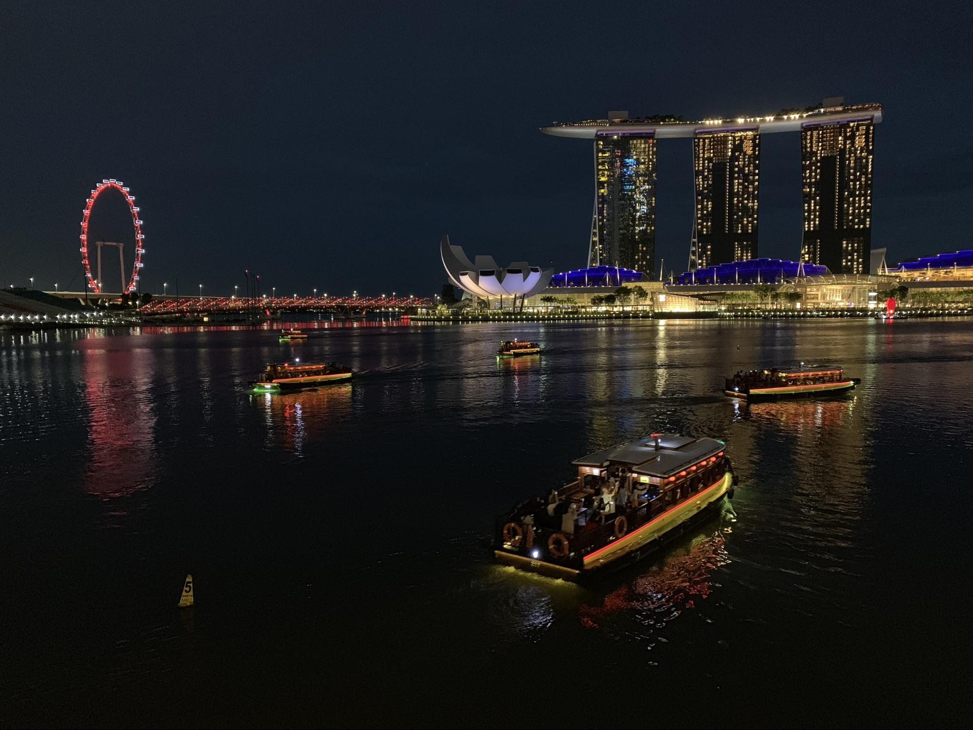 Southeast Asia photo of lake with illuminated boats