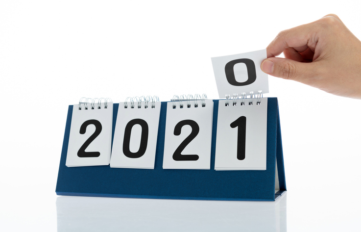 A calendar turning from 2020 to 2021